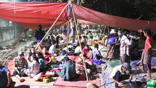 ရွှေပြည်သာစက်မှုဇုန်က Eland Myanmar စက်ရုံရှေ့မှာ ဆန္ဒပြအလုပ်သမားတွေကို ဖေဖော်ဝါရီလ ၂၁ ရက်နေ့ က တွေ့ရစဉ်